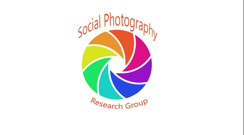 Social Photography Resarch group logo - rainbow coloured camera shutter